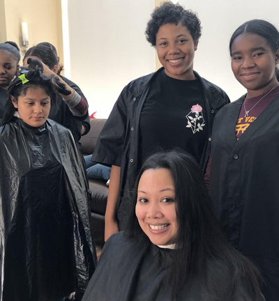 Cosmetology students at The Ronald McDonald House providing haircuts to the residents
