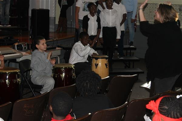 Damien Pryce (right), a sixth-grader at Edward Williams Elementary School, performs for pare